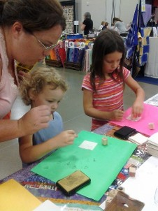 Adinkra Stamp Activity, Original Craft Festival, Sharonville Ohio, One of our UGRR Quilt Code family activities we do at quilt show, youth art programs. We teach and display symbolic languages.
