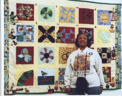 Serena wilson & her UGRR Secret Quilt Code Sampler Quilt that she used to teach how her ancestor Peter & Eliza Farrow successfully did slave escapes.