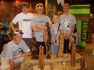 UGRR Secret Quilt Code Museum Exhibit Wood Carving Class Series - East to West in Woods. Pictured are youth with Nigerian carved wood at the UGRR Secret Quilt Code Museum Exhibit