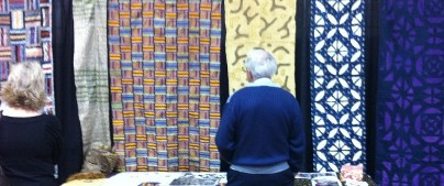 Oct.. 2011 GA Quilt Show patrons view the textiles in the UGRR Secret Quilt Code Museum Traveling Exhibit,