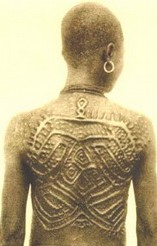 West African Kuba lady showing her back shoowa scarifacation