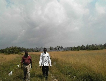 Dr. Njoku & Emmanuel returning from the Atlantic Ocean while retracing slave route through Coconut Island Nigera Africa.