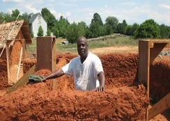 Dr. Akuma-Kalu Njoku, Ph.D. Associate Professor at WKU assisting in building structures at Igbo Farm Village in Frontier Museum located at Staunton, VA 2010.