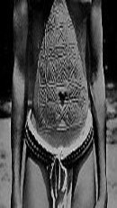 Scarification Art are marks of beauty in West Africa- circa 1940. Here she has the UGRR Quilt Code patterns cut into her skin.
